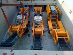 Crushing machine equipment loaded in the hold of a break bulk vessel Port Klang Malaysia for shipping to Fremantle Western Australia